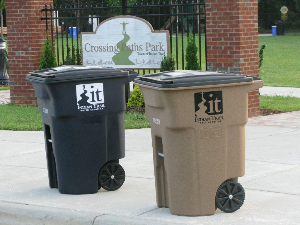 Solid Waste Containters sitting at the curb for pick up